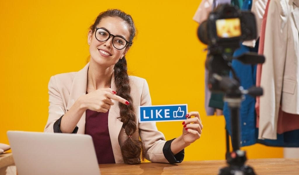 Woman showing a Facebook Like Cut Out Image